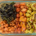 sheet pan power bowl ingredients in glass storage container