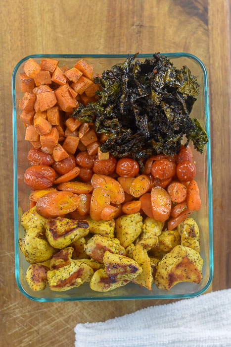 crispy roasted kale, sweet potato, sweet baby tomatoes, carrots, and lemon curry chicken