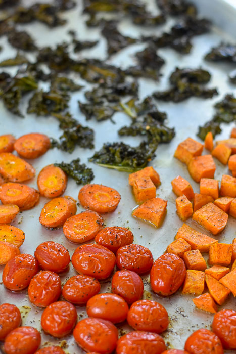 roasted kale, carrots, tomatoes, and sweet potatoes on sheet pan