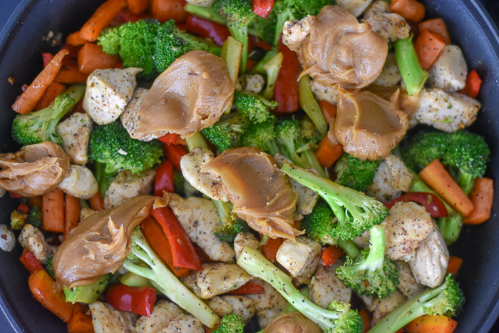 peanut butter sauce over sauteed chicken and vegetables