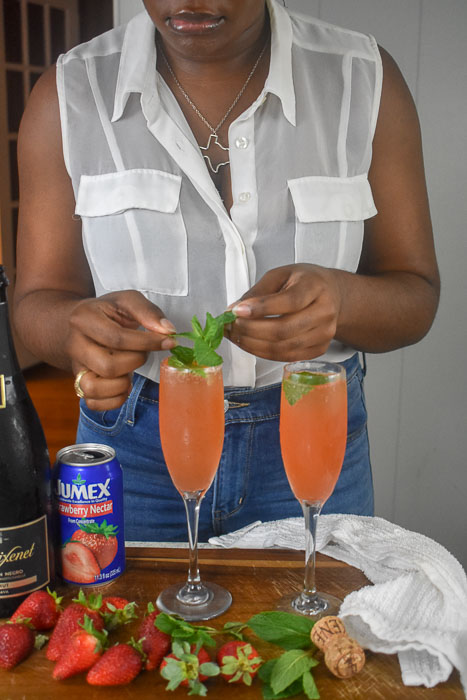adding mint sprigs to mimosas