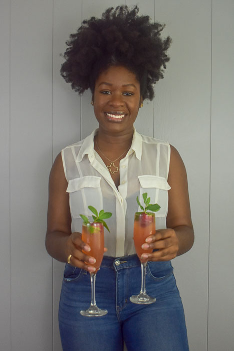 Dash of Jazz holding strawberry mint mimosas