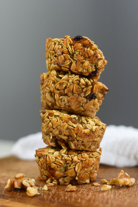 stack of banana nut oatmeal muffins on wood cutting board
