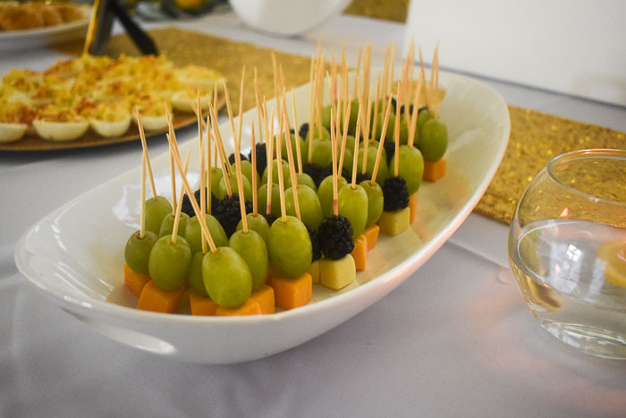 fruit and cheese skewers on tray