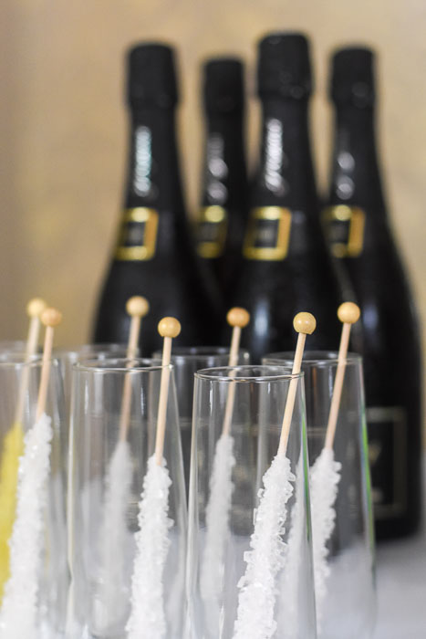 stemless champagne flutes with rock candy stirrers