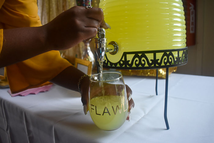 pouring lemonade into wine glass