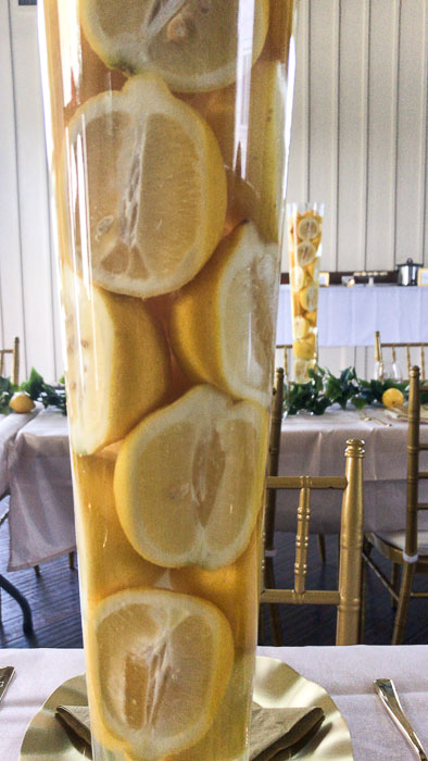 lemons and water in extra large vase on tablescape at bridal shower