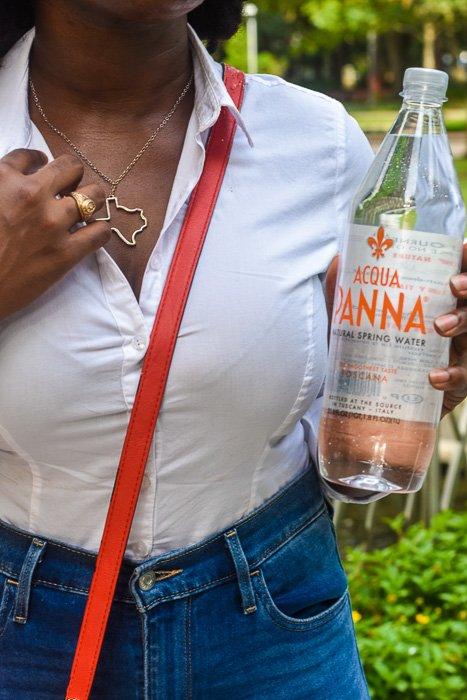 Dash of Jazz holding bottle of Acqua Panna Natural Spring Water