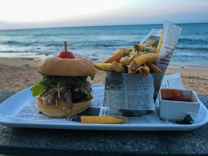 burger and truffle fries at Serafina Beach Hotel pool