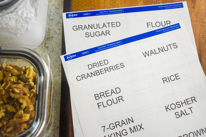 pantry item labels on wooden cutting board