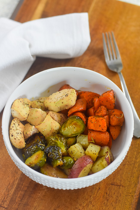 roasted chicken breast, carrots, brussels sprouts, and potatoes in bowl